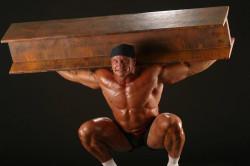 Поднятие тяжестей - причина растяжения мышц